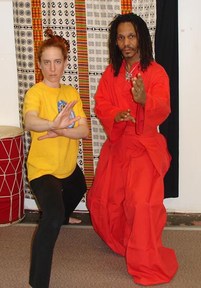 Mfundishi Tayari Casel and student Rebecca Firestone on the training floor.
